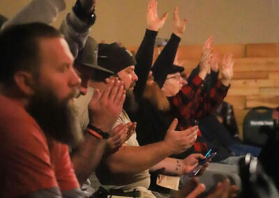 Men Lifting Hands in Praise at Men on Fire